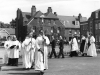 Dedication of the Chapel, Bow Arrow. At Albans Church Wardens Thomas Crowhurst and Norman Beater followed by Rev White, Bishop Say and his servers, 1961.