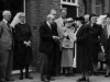 Mrs E Boswell handing the key to Dr T Fathing during the opening of Fathing ward. Watching L-R Rev P Collins, Mr E J Hobbs, Miss Bignall Matron and members of the committee.
