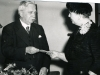 1955, October. Mr Parry retiring from the Dartford Hospital Management Committee. Receiving a gift from Mrs Flora Welch, Vice Chairman.